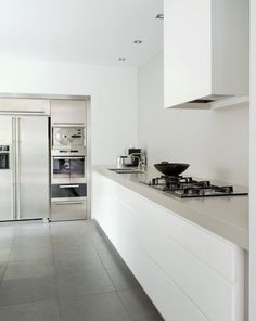Amazing kitchen, love the counter area. Everything is sleek and clean.