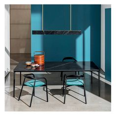 The Slim #table is proposed in the precious Marquinia finish. Slim is combined with the Autumn #chairs in black ash and light blue velvet seat to create an essential and elegant combination both for #residential and #contract #interiors.