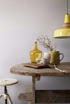 Loving the combination of mustard yellow with rough vintage wooden furniture, yellow glass, grey ceramics, yellow industrial pendant and pale grey walls! Yellow Decor, Decor, Inspiration, Rustic Interiors, Home, Yellow Interior, Interior, Interior Styling, Home Decor
