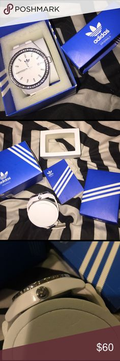 Where Adidas Originals watch Authentic white Adidas Originals Watch. Adjustable band. Comes with original box and everything shown. Excellent used condition. Some minor scuffing on the wrist band. Adidas Accessories Watches
