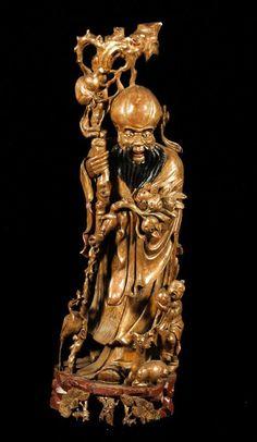 "Antique Chinese figure of Shou Lao, the Daoist god of longevity, carved wood, 39"" h x 10"" dia. Property from various fine estates.  EST: $750 - $1,250      High Bid: 450.00 USD - rareworld"