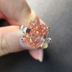 carats Fancy Vivid Pinkish Orange diamond ring with carats tapered baguette diamonds on the side! Perfume, Pink Bling, Baguette Diamond, High Jewelry, Jewellery, Diamond Are A Girls Best Friend, Moissanite, Colored Diamonds, Pink Diamonds