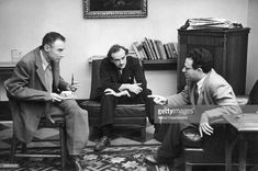 Dutch-born physicist Abraham Pais makes a point to fellow physicists Robert Oppenheimer and Paul Dirac during afternoon tea at Princeton University's Institute for Advanced Study, Princeton, New. Get premium, high resolution news photos at Getty Images Paul Dirac, Institute For Advanced Study, Princeton University, Physicist, Life Pictures, Picture Collection, Albert Einstein, The Life, Science