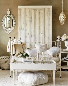 Shabby chic white makes this room full of charm.