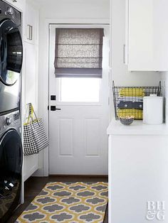 This compact mudroom had hardly any room for a laundry—until a space-saving solution put everything in its place. Stacking the washer and dryer cut space needed for laundry in half, giving storage and work space to the kitchen. Built-in closets and laundry room cabinets give narrow storage and a smal counter space.