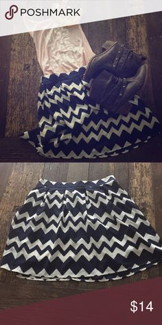 Navy blue and white chevron skirt Gorgeous chevron skirt. Worn once. Excellent condition. It's a steal for $14!!! Skirts Mini