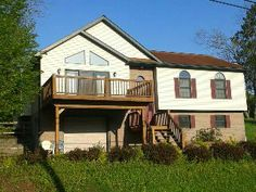 Whisp P Doo Steps from WISP Walking distance to the base of the ski slopes, Enjoy the mountain coaster, paintball, and other WISP activities 5 Bedrooms each offering large, comfortable beds  Covered back deck with hot tub for nice privacy Deep Creek Lake MD