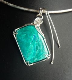 This is one of my creations. Chrysocolla - beautiful colour.