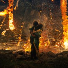 Pompeii (2014) - Milo And Cassia embracing before the Vulcan Cloud takes them. Kit Harington as Milo and Emily Browning as Cassia #CostumeDesign: Wendy Partridge