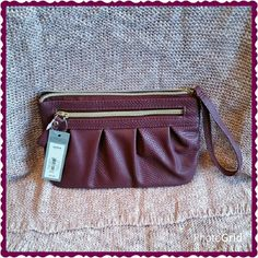 Burgundy wristlet. What a beautiful deep burgundy color. Zip closure.  One outside zipped pocket. One inside zipped pocket. 8 credit card slots inside. 8 inches wide. 5.5 inches tall. Apt. 9 Bags Clutches & Wristlets