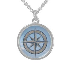 See site as comes with circle with compass design. Would prefer a better compass design on the circle that comes with it. I like that this has images of sand, water and sky making up the compass design, I just wish it was a working compass. Would the seller sell the image so I could get jeweller here to custom make it?  Compass Rose (Sand, Water, Sky) Sterling Silver Necklaces