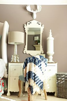 A vanity serves double duty as a bedside table creating a unique and beautiful yet functional space.  Adding decorative touches from HomeGoods makes the perfect statement piece in this master bedroom.  Sponsored by HomeGoods.