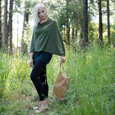 Add a voguish layer to your winter look with this luxuriously soft knit poncho.Slip it over a basic top or tee when the temperature drops.Perfect for breezy. Knit Poncho, Basic Tops, Winter Looks, Knitting, Tees, Jackets, Style, Fashion, Down Jackets