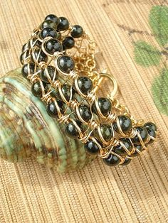 Wire wrapped bracelet dark green glass pearl bangle by catinalife, $42.00