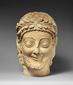 Limestone male head, Archaic, late 6th century B.C., Cypriot, 38.1cm | The Metropolitan Museum of Art