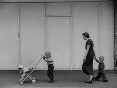 Young Housewife Walking with Her Three Children--nostalgia inducing!