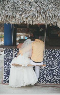 Bride & Groom swinging at beach bar. #DestinationWedding
