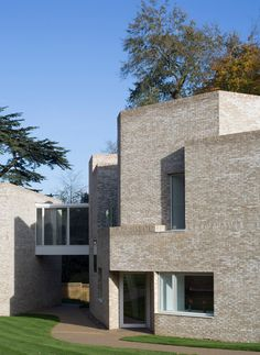 The paler tone of the brick and massing of the buildings – with their irregular arrangement of forms and flat roofs – marks them out distinctly as contemporary additions.