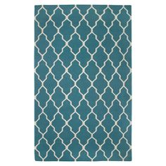 Handmade New Zealand wool rug in teal with a quatrefoil trellis motif.    Product: RugConstruction Material: New Zeala...