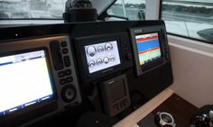 Cruisers Yachts 41 Cantius: The helm features a fiberglass inlay panel that is hinged at the bottom for easy electronics installation. We like the Volvo Penta simulated analog gauges under the compass.