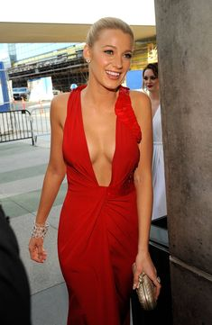 i love blake lively's look in general. she can pull almost anything off and she always looks so elegant and well put together.  this dress is beatiful...although revealing it still looks classy