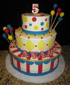 """Carnival Themed cake - 8"""", 12"""", 14"""" cakes all frosted in Pastry Pride, Red stripes and yellow diamond shapes were cut from Wilton sugar sheets. Letters, balloons and polka dots were made from gumpaste. Thanks for looking!"""