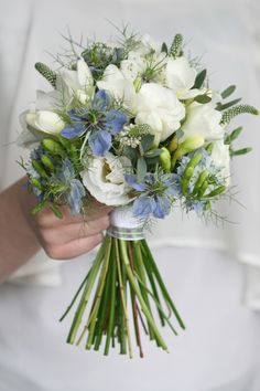 Blue Nigella bouquet with white freesia and white Veronica, white lisianthus