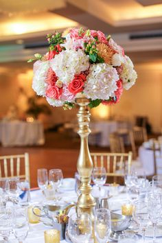 Tall. bright centerpiece idea - white + pink roses, hydrangeas, dahlias and hypericum berries in tall gold vessel {Vanessa Joy Photography}