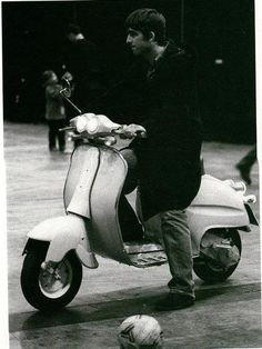 Oasis: Noel Gallagher on scooter, Earls Court, London,