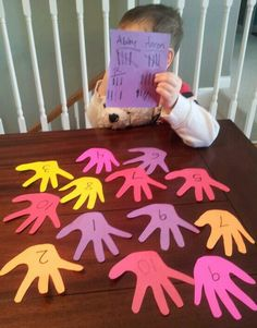 Number Grab! Fun, simple game teaches numbers to preschool child. Trace and cut their hand shape as shown (layer and cut several at once to hasten the process) and number. Have older children challenge the preschooler as you call out a number and everyone grabs for it--letting the lil guy win just by a hair. Keep points and cheer them on: builds confidence!