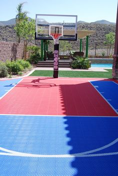 be awesome have a basketball court in backyard