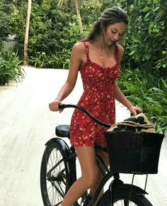 A gorgeous way to spend the summer with breeze blowing through your hair, a cool cotton frock and riding a bicycle...