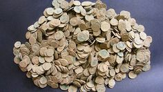 A METAL-DETECTING enthusiast has uncovered a hoard of Roman coins in Mid Wales.  	The exact location of the find, which is believed to include some 4,000 copper coins, is being kept a secret to protect the site.
