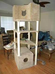 Love the concept, Cat tree with hidden litter box.. possible do a door hinge effect for easy access. Definitely a different design, tunnels and sisal are must haves.