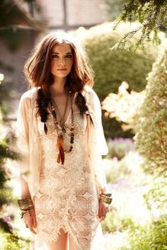 Beautiful bohemian look with lace and feathers.