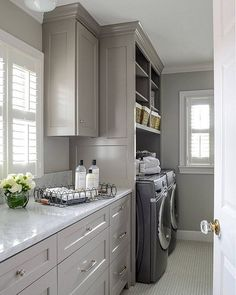 Laundry Room: Beautiful and functional, this former attic was turned into a gorgeous laundry room