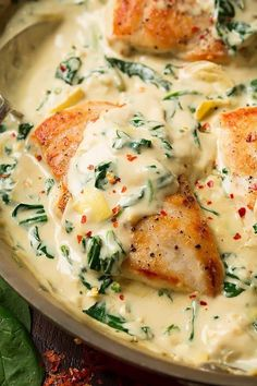 Skillet Chicken with Creamy Spinach Artichoke Sauce | Cooking Classy.