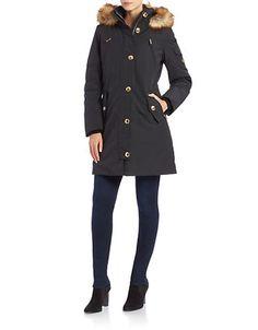 A plush faux-fur trim lends luxurious dimension to this stylish silhouette.
