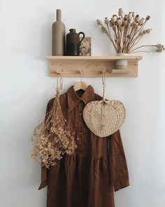 a natural home in the netherlands. raffia fan and terracotta dress hung from simple wood shelf. Living Room Decor, Bedroom Decor, Wall Decor, Whats Wallpaper, Deco Boheme, Mediterranean Decor, Home And Deco, Wood Shelves, Home Decor Accessories