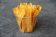 Homemade recipe for chifles, also known as mariquitas, chicharitas, platanutres, platanitos or plataninas, or thin fried green plantain (or green banana) chips.