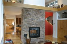 stone fireplace between kitchen and family room