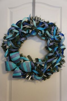 Frosted Blue Upcycled Holiday Wreath by BeyondBottles on Etsy, $40.00