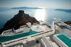 Santorini getaway carved into volcanic cliffs