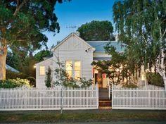 pretty white timber house