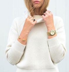 So cozy. A testament to jewelry changing the look of any outfit, even a basic cream turtleneck sweater.