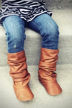 One of the best things about fall are fun and fashionable toddler boots! Our tan slouch boot is made with a camel colored faux leather. These are a must for your baby's fall and winter wardrobe.Bitsy Blossom shoes are all handmade and created with great care and attention to detail. All of our shoes are made with modern and unique textiles. The insole is lightly padded for extra comfort. The soling material is waterproof, durable, abrasion resistant, slip resistant, and resistan...