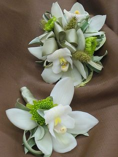 cymbidium orchid corsage and boutonniere by bills house of flowers, via Flickr