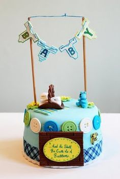 baby shower cake idea- love the banner and buttons around it