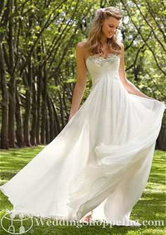 delicate chiffon that features a romantic strapless sweetheart neckline that is heavily beaded at the trim to add the perfect amount of sparkle and detail. The empire waist features cascading chiffon that drapes softly to the floor creating a whimsical and romantic A-line silhouette.