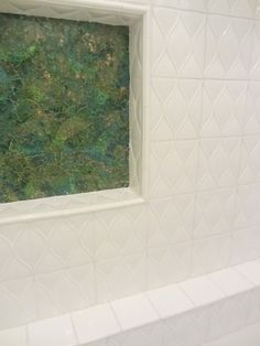 White dimensional ceramic tile and trim with custom color glass for shampoo niche - Galveston project - ADR